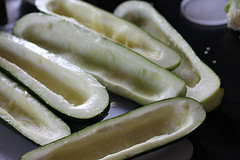 preparing stuffed Zucchinis
