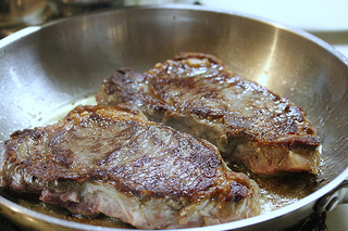 pan frying new york strip steaks