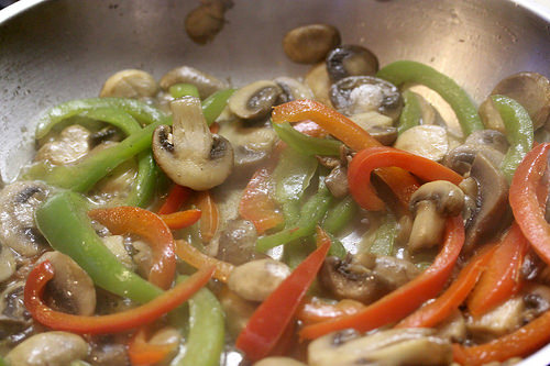 cooking mushrooms and peppers
